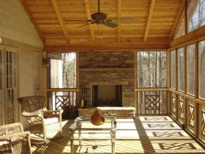 Outdoor fireplace on screened porch