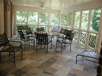 An inspiring convertibility possibility screened porch or for Covered porch flooring options