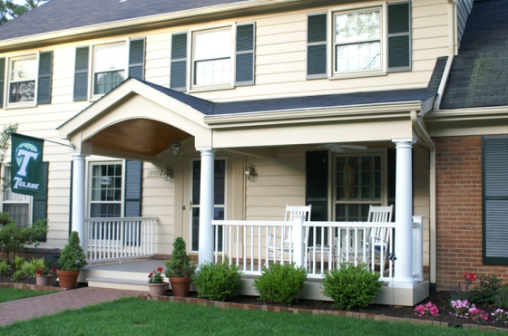 This photo shows the new and improved front porch area perfect for these Rockville, MD homeowners to enjoy their beautifully landscaped front yard.