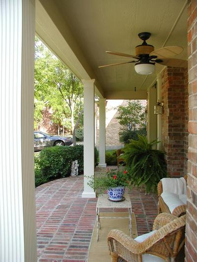 An Open Front Porch That Uses Hardscapes And Beautiful Columns