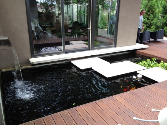 Tranquil bamboo deck alongside a Zen inspired water feature. Photo courtesy Dasso XTR.